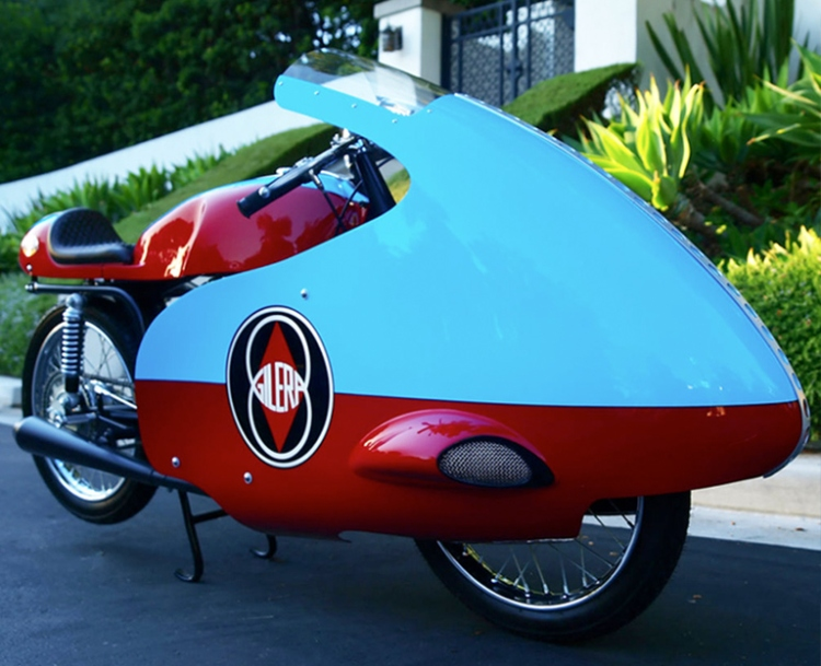 1957 Gilera 125 Road race. This fairing provided typically about 20 mph additional top speed on the smaller displacement with significant drawback in case of lateral wind which led to crashes and a ban from the FIM for road racing.