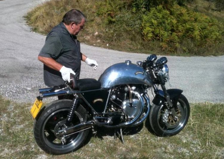 Colin preparing a bike for her first road laps after restoration. Note that the pipes are under the seat.