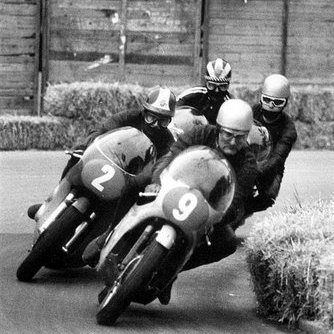 1.Four Aces in a bend: Mike Hailwood leading the way (9), Giacomo Agostini (2), Renzo Pasolini just behind Hailwood and Phil Read.