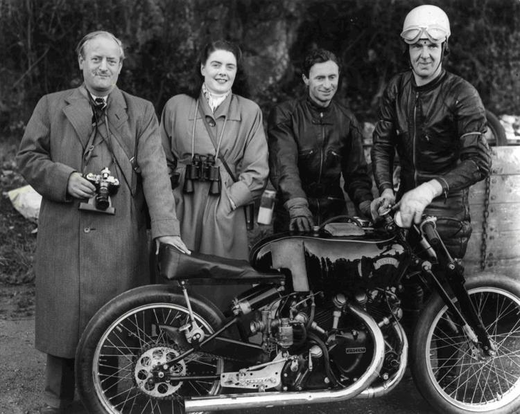 "G As Gunga Din, the most famous Vincent works racer. It was the development bike for the Black Lightning and the Black Shadow and was raced by George Brown.On the Picture Philipe Vincent on the left, his wife Elfrida, reserve pilor Dennis O'Neill and Harry Lindsay in May 1953, at Carrigrohane, Ireland. Harry Lindsay used the Vincent ""Gunga Din"" to set a new Irish speed record of 143 mph."