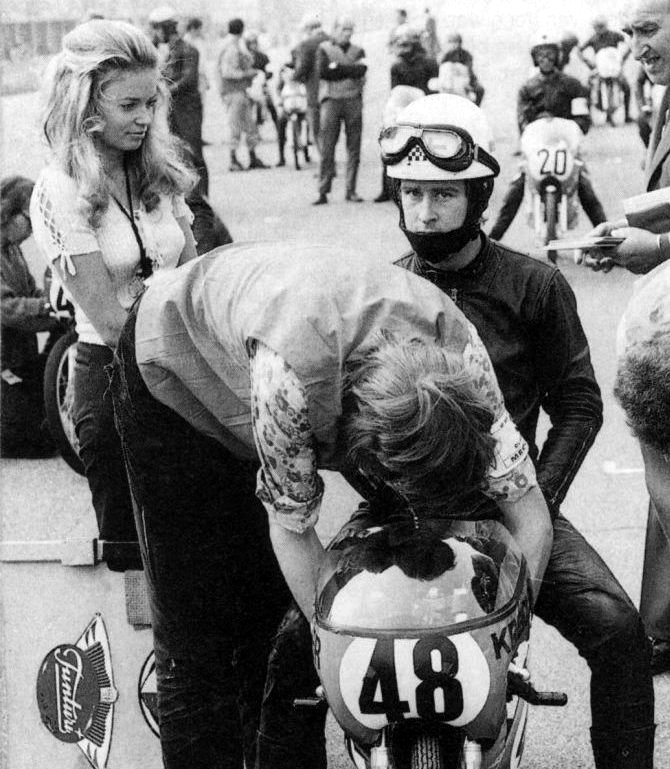 22.For Jarno Saarinen, I had to select a picture with his wife, which was supporting him in every race. There is a famous shot where Soeli is simply dressed with a bikini holding high the stopwatch board in the pit lane. I leave you make some research on Google  Active racing:1970 - 1973 Team: Yamaha Won 1 Championship  250cc | 1972