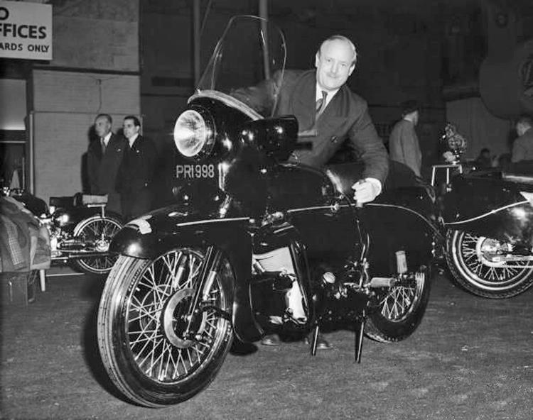 "P As Philip Conrad Vincent (1908-1979), known by enthusiasts as PCV. He bought H.R.D. from Howard R. Davies in 1928 for £450 and established the Vincent HRD Co., Ltd. The logo was changed, adding ""The Vincent"" in very small letters over the top of the bold HRD and new models were introduced. PCV is here with PRI 998, the road test Black Prince."
