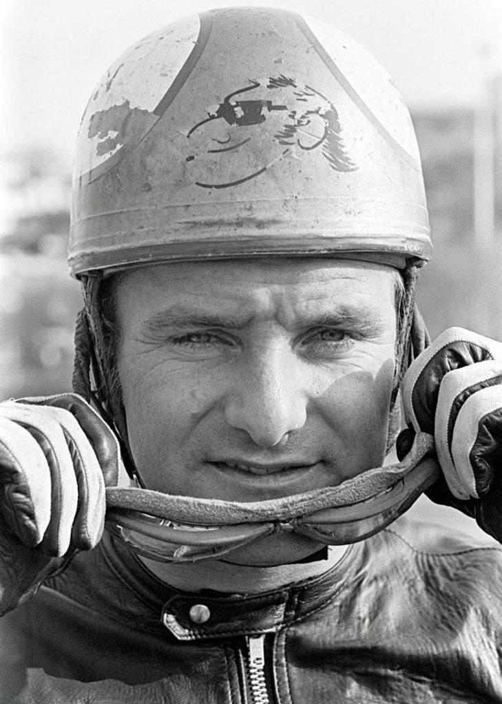 6. In 1968, Mike Hailwood competed and rode a 500cc Honda. Note the caricature on his helmet which replaced the checkered and union jack flag that year. Active racing1958–1979 Teams: Honda, MV Agusta and Ducati for the TT Won 9 Championships 250cc | 1961, 1966, 1967 350cc | 1966, 1967 500cc | 1962, 1963, 1964, 1965 Mike also contested 12 Isle of Man TTs (1958-1967, 1978, 1979), won 14 and made 19 Podiums.