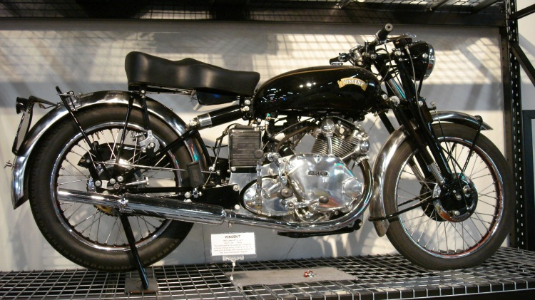 "C The Series C introduced in 1948 some major suspensions upgrades such the Girdraulic front fork and a hydraulic damper for the rear cantilever; the Rear frame (RFM) is easily recognizable because the seat dampers brackets have a bean shape. Later will come the brand switch between ""HRD"" and ""The Vincent"", on the tank, crankcases, timing cover and service caps. Production includes 3,893 Comet, 2,725 Rapide, 1,469 Black Shadow, 15 White Shadow, 33 Black Lightning and 31 Grey Flash. This is the 500 Comet Series C"