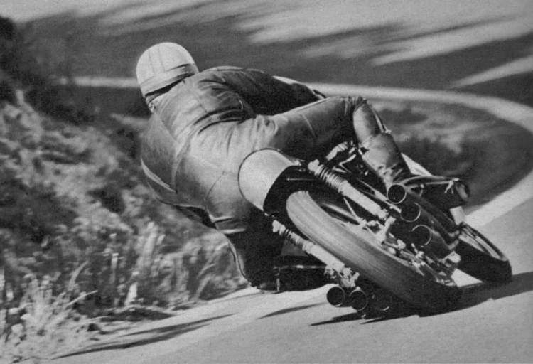 7. One of the most famous picture of Mike Hailwood, on the RC166, the Honda 250 cc 6 cylinders.