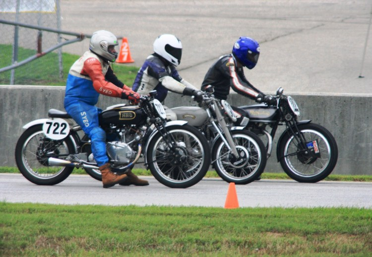 From left to right, Tom Kerr on a Comet B, David Dunfey  on the Comet C and Alex McLane on the Stu Rogers Norton on the starting line at Virginia International Raceway.