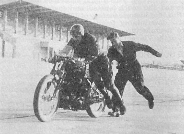 Ted Davies on the Lightning, gets a push off from Jacl Lazenby, during the Montlhery record attempt. This picture supplied by Ted Davies himself shows that the record bike is indeed different from the official pictures.