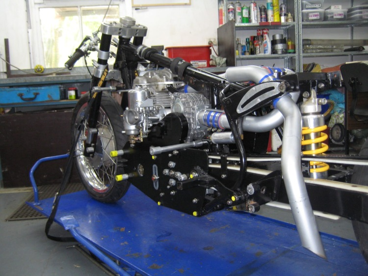 The supercharged record breaker Velocette in late 2012. We can see the supercharger, its drive and enormous SU carb, as well as the monoshock rear suspension and massive front fork assembly. | Picture Stuart Hooper