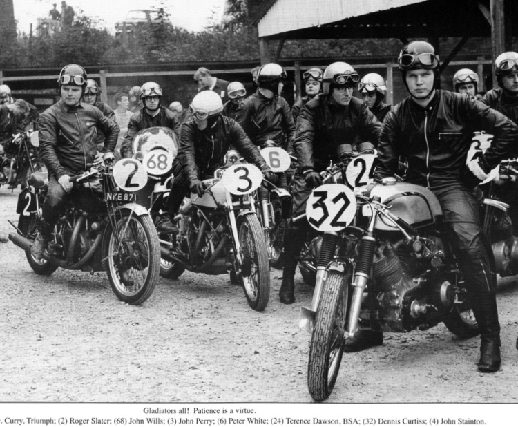 Cadwell Park, 1967: Denis Curtis on his Curtis-Vincent #32. This was one of the Vincent Owners' Club many race meetings at the circuit. Pilots are waiting for the 'out'. Another famous Vincent name is Roger Slater on #2, later importer and constructer of Egli-Vincents, and veteran West London section member and Parkin-Vincent racer Ken Chamberlin #24, behind Curtis. Photo courtesy of Geoff Preece.