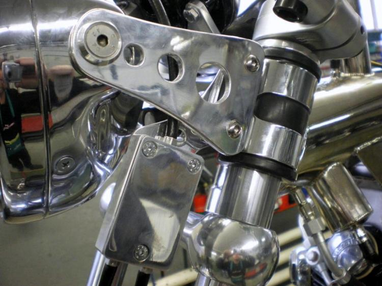 The Headlamp brackets and the front brake equalizer (left | right)