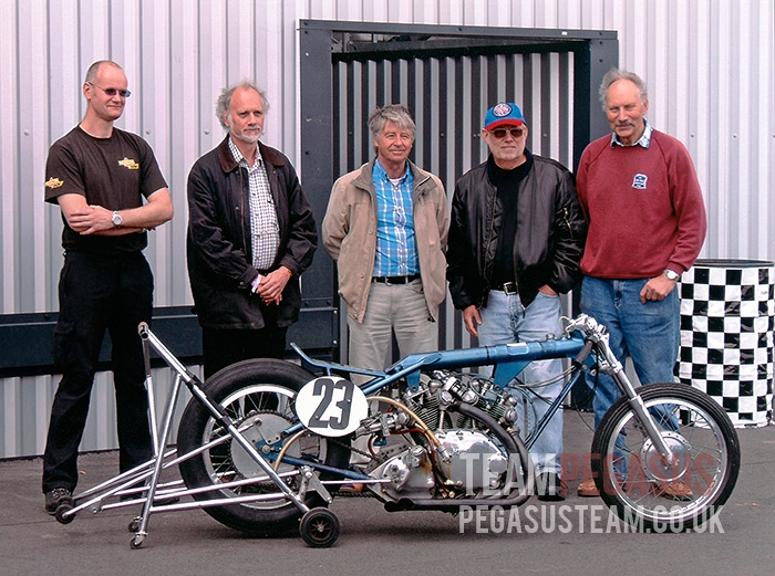 """Team Pegasus members brought together in 2011: Derek, Mick & Ian flanked by Graham Martin (left) and Eddie Keightly (right) with Derek's replica Vincent sprinter"". Information TeamPegasus"
