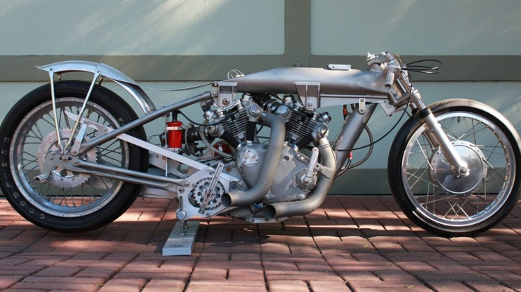 The upper spine holds the nitro-methane while the vertical one in front of the engine holds the oil. The Nitro double the horse power than the engine is capable to deliver with regular fuel. The frame is all made of aluminum.
