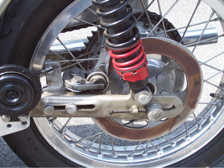 Photo of the rear Campagnolo mechanical single disc. The disc can be positioned on the disc by the two bolts through the swing arm on the left. Often owners extend or add welds to the lever arm to get better braking. Credit: David Dunfey