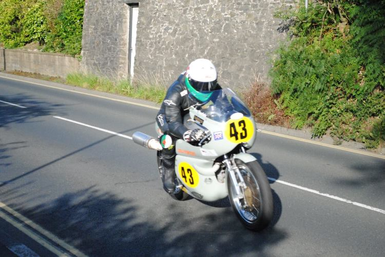 Alex Sinclair's #43 Egli-Vincent hit oil and went down at Ballaugh Bridge. Alex suffered a fractured left thumb (not the accelerator side) but remained in good spirit.